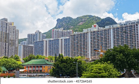hong kong public estate with landmark lion rock at day