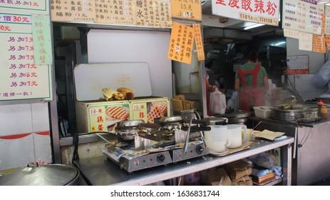 Hong Kong, SAR / China - April 29, 2017:  Egg Waffle Street Side Food Vendor in Downtown