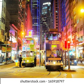 Hong Kong S.A.R. - January 14, 2013: Trams on the street  in Hong Kong. Trams in Hong Kong have not only been a form of transport for over 100 years, but also a major tourist attraction.