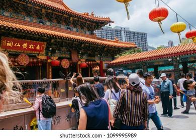 Hong Kong, Hong Kong SAR, May 12 2018, Sik Sik Yuen Wong Tai Sin Temple, visitors look toward the temple.