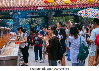 Hong Kong, Hong Kong SAR, May 12 2018, Sik Sik Yuen Wong Tai Sin Temple, visitors praying at the temple