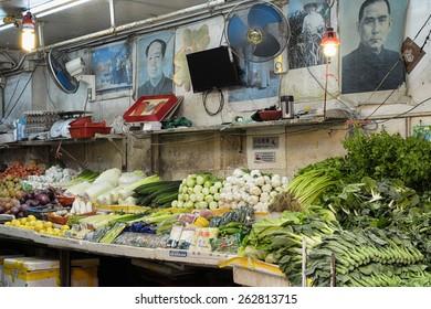 Hong Kong, Hong Kong SAR -November 12, 2014:  Bowrington Road Market in Hong Kong. Vegetable stall in Hong Kong,  Bowrington Road, Wanchai. (Portrait of Mao Zedong is displayed on the wall.)