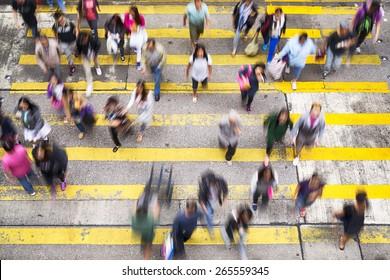 Hong Kong, Hong Kong SAR - November 13, 2014: Crowded pedestrian crossing during rush hour in Hong Kong.