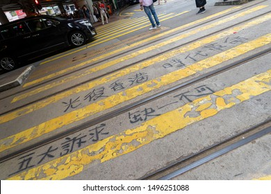 """Hong Kong - Sep 03, 2019: Hong Kong Water Revolution, Chinese wordings on road cross written as """"Liberate Hong Kong; The Revolution of Our Times"""" and """"5 demands, not one less"""""""