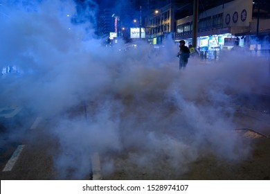 Hong Kong - Sep 21, 2019:  Peaceful sit down at Yuen Long MTR station. However, police use Tear gas to disperse the leaving crown.