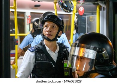 Hong Kong - Sep 3, 2019:  Protests during the general strike in Hong Kong, Sep 2019. Protestors travel by bus, however the bus in intercepted by Police.