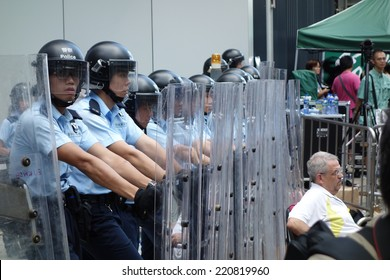 HONG KONG - SEP.27: around 100 protesters climb over the fence to reclaim the Civic Square. Riot police are deployed at the main entrance of the square