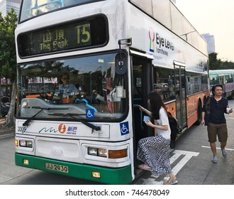 HONG KONG - SEPT 2017: A woman gets on a bus 15 driving to and from Victoria Peak, a mountain in the western half of Hong Kong Island. It is also known as Mount Austin and locally as The Peak.