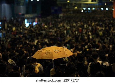 """HONG KONG, SEPT.29: protester holding the umbrella which the word mean"""" change"""" on it in Admiralty on 29 Sept 2014. umbrella become the sign after riot police fire tear shell in peaceful rally"""