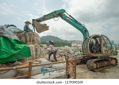 Hong Kong, September 14, 2018: Workers are seen working on flood walls in Lei Yue Mun as Super Typhoon Mangkhut is approaching Hong Kong. Coastal houses were severely flooded by Typhoon Hato in 2017.