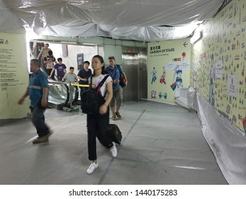 HONG KONG - SEPTEMBER 15, 2017: People enter East Tsim Sha Tsui Railway Station by Avenue of Stars which is under redevelopment and expansion till 2018.