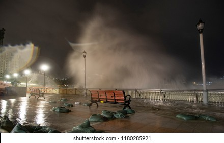 Hong Kong, September 16, 2018: A metre-high wall of sandbags at the waterfront of Heng Fa Chuen is washed apart by rough waves as Severe Typhoon Mangkhut hits the city.