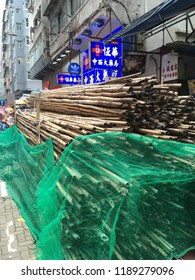 HONG KONG - SEPTEMBER 17, 2017: A stack of bamboo scaffolding in the street. This cheap traditional natural material is much popular in the highly developed city.