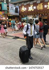HONG KONG - SEPTEMBER 17, 2017: An unidentified man wearing a steampunk helmet is going to perform in a Hong Kong street.