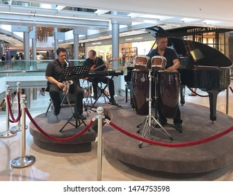 HONG KONG - SEPTEMBER 17, 2017: Unidentified musicians perform at the IFC Mall, a 4 storey shopping mall with many luxury retail brands and wide variety of restaurants.