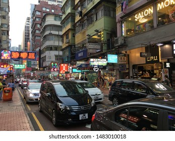 HONG KONG - SEPTEMBER 17, 2017: Lots of vehicles drive in the street in Mong Kok district. Mong Kok is one of the major shopping areas in Hong Kong