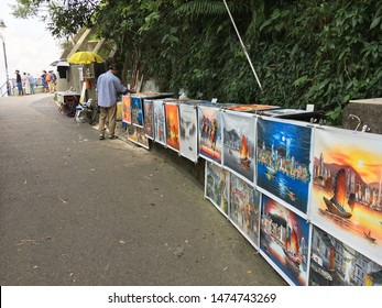 HONG KONG - SEPTEMBER 18, 2017: Paintings for sale at Victoria Peak, a mountain in the western half of Hong Kong Island. It is also known as Mount Austin and locally as The Peak.