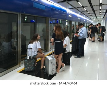 HONG KONG - SEPTEMBER 19, 2017: People wait for the Automated People Mover at the Hong Kong International airport to get to Terminal 2.