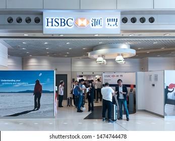 HONG KONG - SEPTEMBER 19, 2017: People at an HSBC office located in the Hong Kong International airport.