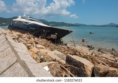 Hong Kong, September 19, 2018: A superyacht is washed ashore by Typhoon Mangkhut near Sai Kung public pier. Typhoon Mangkhut is the most intense storm ever to hit Hong Kong since records began.