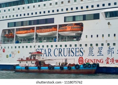 HONG KONG - September 2, 2017: Small technical vessel providing service toa big cruise ship in port.