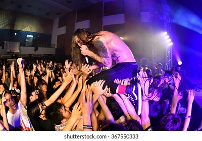 HONG KONG - SEPTEMBER 20, 2015: While She Sleeps show, Vocalist Lawrence Taylor crowdsurfing to the crowd