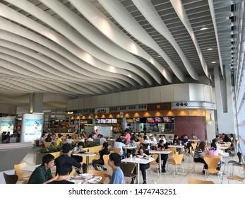 HONG KONG - SEPTEMBER 2017: People have meals at the Hong Kong International airport food court.