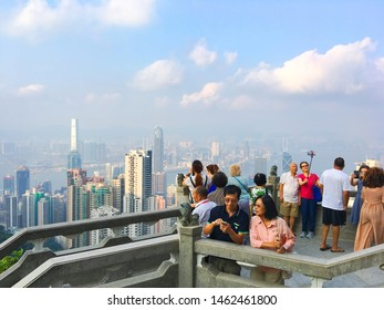 HONG KONG - SEPTEMBER 2017: Tourists enjoy a view from Victoria Peak, a mountain in the western half of Hong Kong Island. It is also known as Mount Austin and locally as The Peak