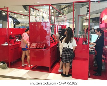 HONG KONG - SEPTEMBER 2017: Young women shop at the Armani Box store in the IFC Mall, a 4 storey shopping mall with many luxury retail brands and wide variety of restaurants.
