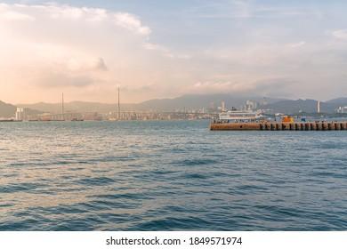 Hong Kong - September 22, 2020: Skyline at Sunset, Instagram Pier and Stonecutters Bridge