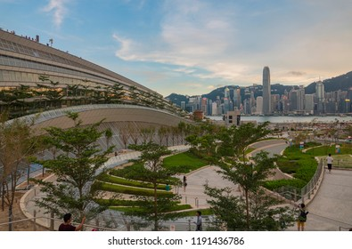 Hong Kong, September 23, 2018: People are seen at the landscape deck and cultural plaza above the West Kowloon Terminus of Guangzhou-Shenzhen-Hong Kong High Speed Rail with a view of Victoria Harbour.