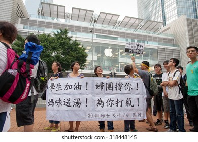 """Hong Kong - September 24, 2014: Third Day of 2014 Hong Kong class boycott campaign. Protesters walk to Central and show banner with message of """"Cheer up students! We support you!""""."""