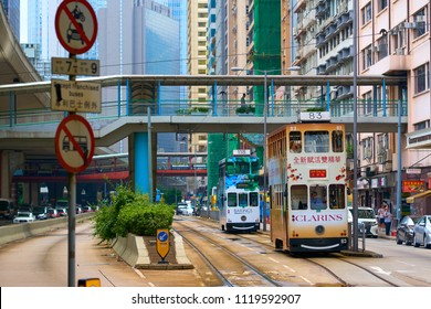 HONG KONG - September 5, 2017: Double decker trams moving under elevated walkway. Public Transport in Hong Kong.