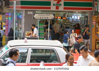 HONG KONG - September 5, 2017: People and cars on the overcrowded street of the big city.