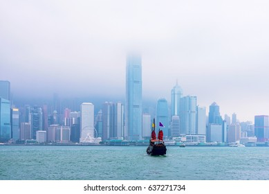 Hong Kong skyline and boat on a cloudy rainy day
