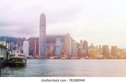 Hong Kong skyline with boats and sunlight in Victoria Harbor