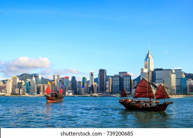 Hong Kong skyline cityscape, Tourist junk boat at Victoria Harbor in evening
