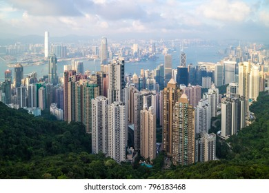 Hong Kong skyline cityscape and Victoria Harbor, view from the Peak at day time (afternoon)