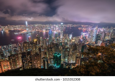 Hong Kong skyline at night, shows the densely populated city. Hong Kong at the foreground with Kowloon at the back, and Victoria Harbor separating them.