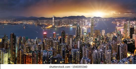 Hong Kong skyline panorama at dramatic sunset, China - Asia