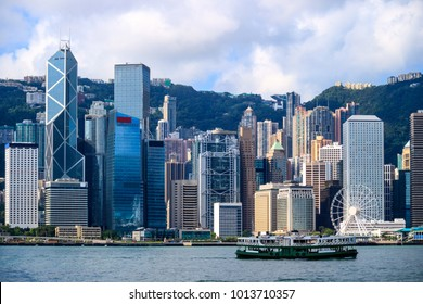 Hong Kong skyline and passenger ferry transportation on Victoria harbor at sunrise morning