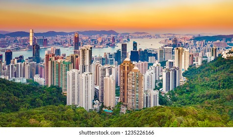 Hong Kong skyline at sunset. View from Victoria peak. Panorama