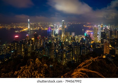 Hong Kong skyline and Victoria Harbor, view from the Peak at twilight