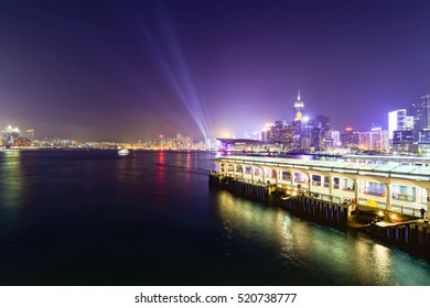 Hong Kong skyscrapers at night with boats in movement