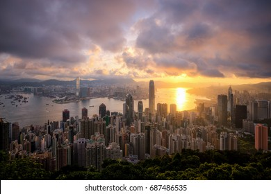Hong Kong sun rise, China city skyline from Victoria Peak.
