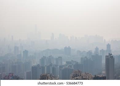 Hong kong tall buildings in haze at day