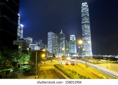 Hong Kong traffic and skyscraper offices at night