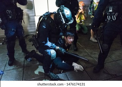 Hong Kong, Tsim Sha Tsui - 11 August, 2019: Protest against Hong Kong extradition bill. Police in the Tsim Sha Tsui police station shoot teargas and rubber bullets to protesters indiscriminately.