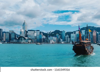 Hong Kong Victoria Harbor view with junk boat on foreground