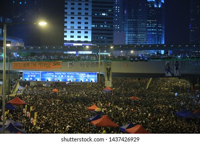 Hong Kong-30 September 2014: protesters occupy the street near government headquarter in Admiralty on . after riot police fire tear shell to the peaceful protesters, people join the protest